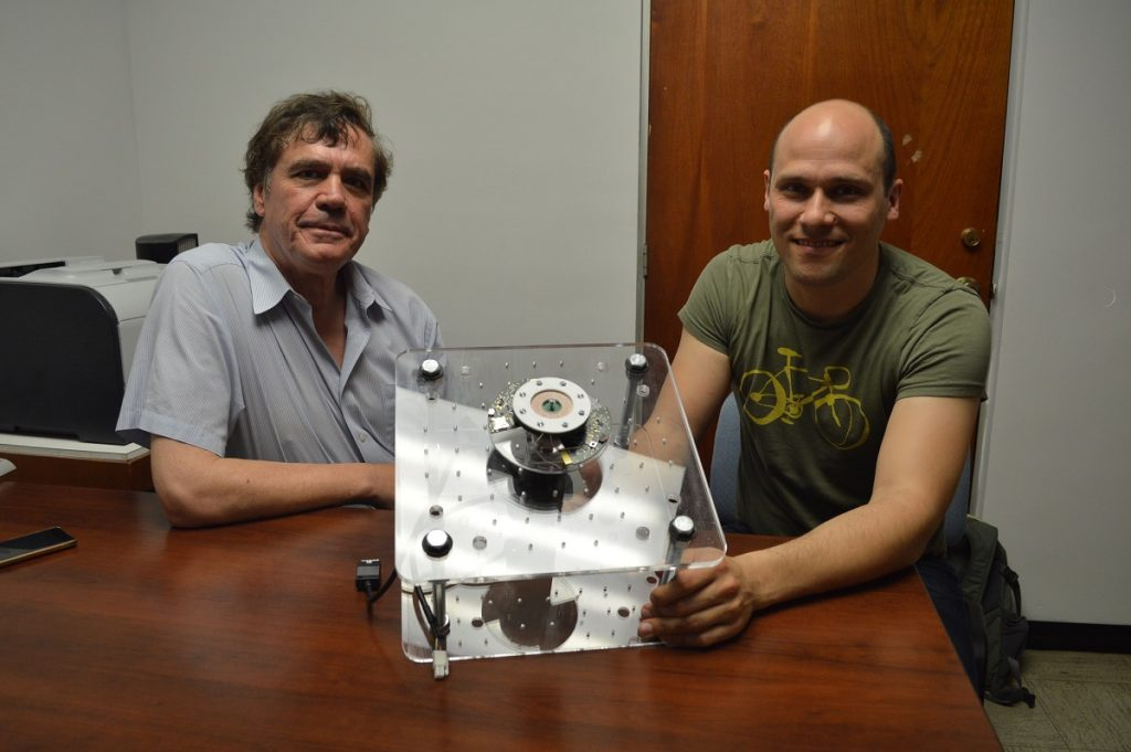 Prof. Marc Madou from University of California, Irvine and Dario Mager from KIT university showing a lab-on-a-CD.